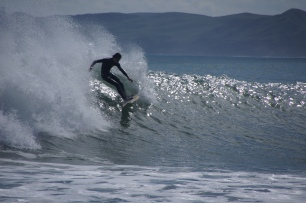 Surfer at Manu Bay