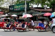 Rickshaws taking on the Penang traffic