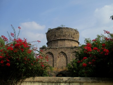 Unfinished tomb with splendid bougainvillea
